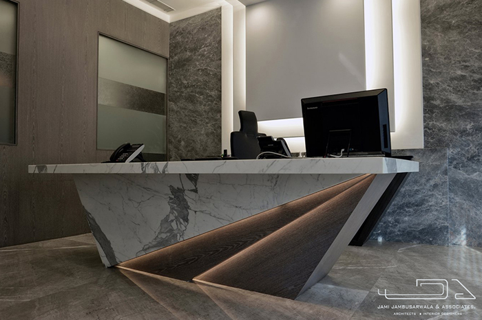 The Directors Table Has Been Designed In Marble Leather And Veneer With Sharp Edges A Staggered Apron Indirectly Lit Levels